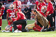 San Francisco 49ers defensive end DeForest Buckner (99) is tended to after an injury against the Dallas Cowboys at Levis Stadium in Santa Clara, Calif., on October 2, 2016. (Stan Olszewski/Special to S.F. Examiner)