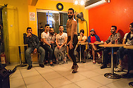 Wissam, a gay Syrian refugee in Istanbul dances at the My Dubai Cafe in the city, before an audience of other LGBT refugees from Syria and Iraq. Muhammed Wisam Sankari, also a gay Syrian man (wearing a black baseball cap at rear) was recently murdered in Istanbul and reportedly beheaded in a homophobic attack