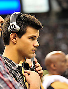 Twilight series ACTOR TAYLOR LAUTNER  wears a headset and listens as the plays are being called on the New Orleans Sainst sidelines during the game against the St. Louis Rams. LAUTNER and poses with Saints owner Rita Benson Leblanc  prior to the kick off against the St. Louis Ram.The New Orleans Saints play the St. Louis rams in New Orleans at the Super Dome Sunday Dec. 12,2010. Saints won 31-13.Photo©SuziAltman. New Orleans, Louisiana, U.S. - Twilight Actor TAYLOR LAUTNER hangs out on the Saints sidelines prior to the kick off against the St. Louis Ram.The New Orleans Saints play the St. Louis rams in New Orleans at the Super Dome Sunday Dec. 12,2010. Saints went on to win 31-13..(Credit Image: © Suzi Singer and actress MILEY CYRUS poses for a fan's camera phone with New Orleans police officers on the sidelines prior to The New Orleans Saints' kickoff against the St. Louis Rams at the Superdome. Cyrus is currently filming ''So Undercover'' in New Orleans.Photo©Suzi Altman Twilight series ACTOR TAYLOR LAUTNER  wears a headset and listens as the plays are being called on the New Orleans Sainst sidelines during the game against the St. Louis Rams. LAUTNER and poses with Saints owner Rita Benson Leblanc  prior to the kick off against the St. Louis Ram.The New Orleans Saints play the St. Louis rams in New Orleans at the Super Dome Sunday Dec. 12,2010. Saints won 31-13.Photo©SuziAltman. New Orleans, Louisiana, U.S. - Twilight Actor TAYLOR LAUTNER hangs out on the Saints sidelines prior to the kick off against the St. Louis Ram.The New Orleans Saints play the St. Louis rams in New Orleans at the Super Dome Sunday Dec. 12,2010. Saints went on to win 31-13..(Credit Image: © Suzi Singer and actress MILEY CYRUS poses for a fan's camera phone with New Orleans police officers on the sidelines prior to The New Orleans Saints' kickoff against the St. Louis Rams at the Superdome. Cyrus is currently filming ''So Undercover'' in New Orleans.Photo©Suzi Altman