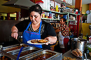 Doña Cleme serves up homemade meals at her small restaurant in the old market district of Tequila.