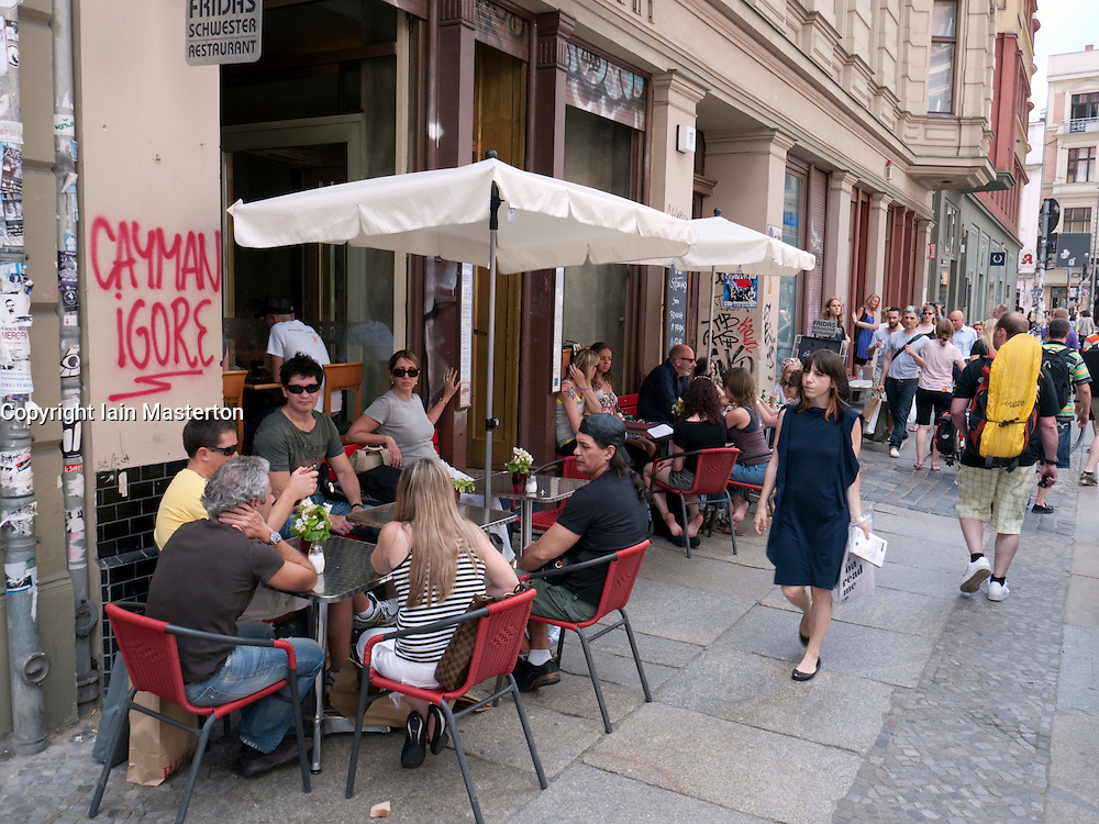 Trendy street cafe and restaurant on bohemian Neue Schonhauser Allee in Mitte Berlin Germany