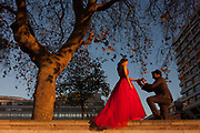 A young couple pose for wedding photos on the Southbank, on 29th November 2016, in London England. London, like many world cities, the wedding photo market is a popular location for young Asians - mainly Chinese - and the famous landmarks serve as perfect backdrops for utopian memories. Behind them is the River Thames and opposite, the Houses of Parliament.