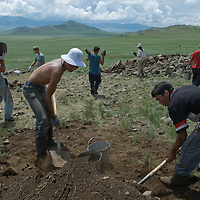 A Smithsonian Museum archaeology team led by Dr. Bruno Frohlich unearths a 2700+ year-old, khirigsur burial mound at a site above the Delger River Valley, near Muren, Mongolia.