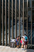 A family admire an art instillation, part of the annual Art in the City project, on 21st July 2021, in the City of London, England.