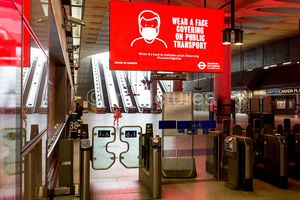 As the UKs Conornavirus pandemic lockdown continues, but with travel restrictions and social distancing rules starting to ease after three months of closures and isolation, Transport for London is following the governments call for face coverings to be worn on all public transport from June 15th next week, at the barriers of London Undergrounds Canary Wharf station, on 9th June 2020, in London, England.