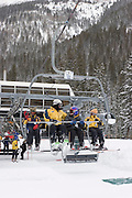 Vertical of skiers riding lift at Taos Ski Valley