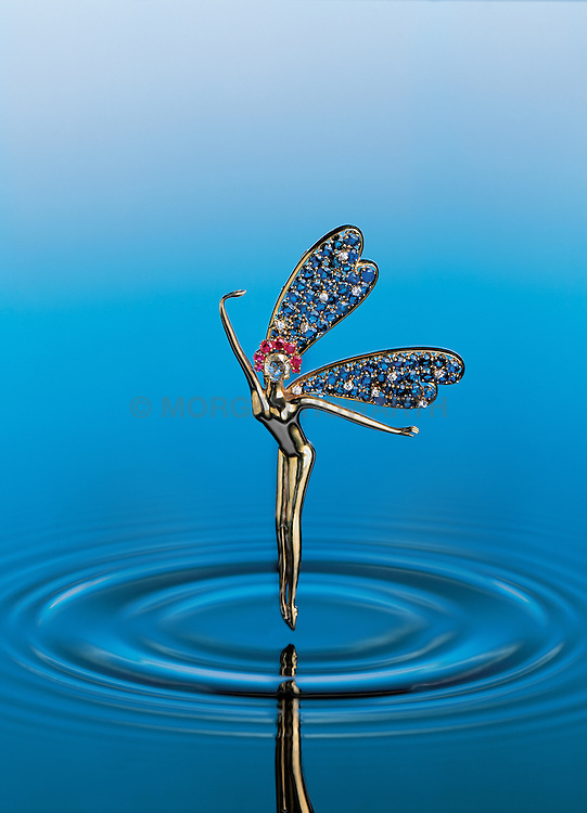 "Van cleef & Arpels created a famous series of ""ballerina""jewelry. the most sought after model was the exotic ""femme libellule"" or dragonfly woman. this gracefully sculpted 18 karat gold fairy is et with a rose cut diamond face, a burma ruby halo and Ceylon sapphire and diamond wings."