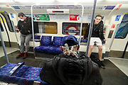 April 8, 2020, London, England, United Kingdom: People are seen wearing face protective masks throughout London underground stations on Wednesday, April 8, 2020 -  as the UK continues in lockdown to help curb the spread of the coronavirus. (Credit Image: © Vedat Xhymshiti/ZUMA Wire)