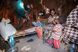 27 January 2019, Burka Dare IDP site, near Micha, Seweyna woreda, Bale Zone, Oromia, Ethiopia: Halima Ismael is one of many Oromo internally displaced people living in the Burka Dare IDP site. People at the site live in small huts or houses. Halima and her children share this one with two other households. The Lutheran World Federation supports internally displaced people in several regions of Ethiopia, through emergency response on water, sanitation and hygiene (WASH) as well as long-term development and empowerment projects, to help build resilience and adapt communities' lifestyles to a changing climate.