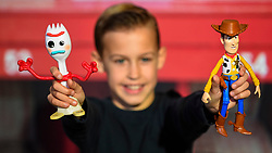 "© Licensed to London News Pictures. 13/11/2019. LONDON, UK. Charlie (aged 10) plays with Forky and Woody from Toy Story 4 True Talkers by Mattel at the preview of ""DreamToys"", the official toys and games Christmas Preview, held at St Mary's Church in Marylebone.  Recognised as the countdown to Christmas, the Toy Retailer's Association, an independent panel of leading UK toy retailers, have selected the definitive and most authoritative list of which toys will be the hottest property this Christmas.  Photo credit: Stephen Chung/LNP"