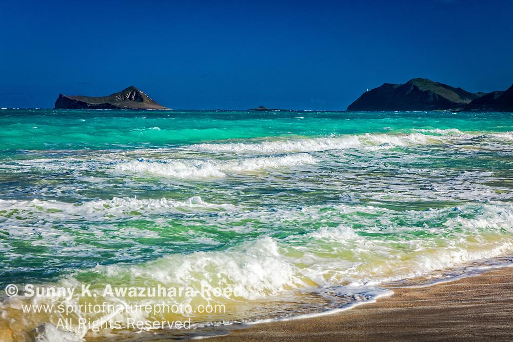 Bellows Beach with Rabbit Island and Koʻolau Range under blue sky, Oahu Island, Hawaii.
