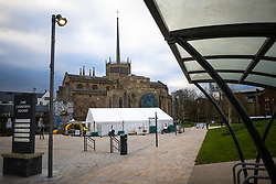 © Licensed to London News Pictures . 19/03/2021. Blackburn , UK . An NHS vaccine centre built in a large tent in the middle of Cathedral Square in front of Blackburn Cathedral . Exploring a year of experiences , lessons and consequences of Coronavirus in the NW of England . Photo credit : Joel Goodman/LNP