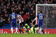 Nico Yennaris of Brentford (2L) has an attempt at goal saved by goalkeeper Asmir Begovic of Chelsea. The Emirates FA Cup 4th round match, Chelsea v Brentford at Stamford Bridge in London on Saturday 28th January 2017.<br /> pic by Steffan Bowen, Andrew Orchard sports photography.