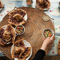 A family meal of m'sakhan in a home in the village of Burqin, West Bank.