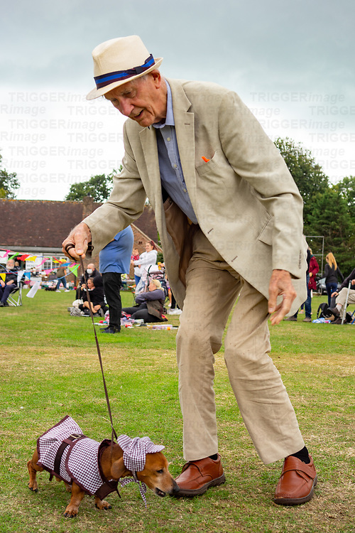 Elderly male dog owner at Climping dog show in West Sussex, England