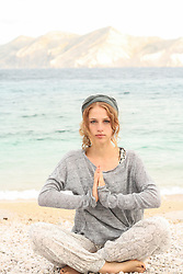 Healthy woman doing meditation on the beach, Baska, Croatia