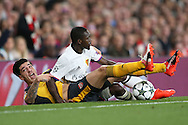 Hector Bellerin of Arsenal and Adama Traore of FC Basel collide as they both compete for the ball. UEFA Champions league group A match, Arsenal v FC Basel at the Emirates Stadium in London on Wednesday 28th September 2016.<br /> pic by John Patrick Fletcher, Andrew Orchard sports photography.