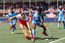 (L-R) Mirco Pruyser of The Netherlands, Surender Kumar of India during the Champions Trophy match between the Netherlands and India on the fields of BH&BC Breda on June 30, 2018 in Breda, the Netherlands