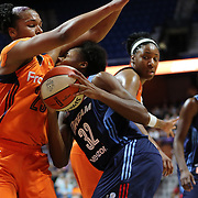 UNCASVILLE, CONNECTICUT- JUNE 3: Bria Holmes #32 of the Atlanta Dream is blocked by Alyssa Thomas #25 of the Connecticut Sunas she drives to the basket during the Atlanta Dream Vs Connecticut Sun, WNBA regular season game at Mohegan Sun Arena on June 3, 2016 in Uncasville, Connecticut. (Photo by Tim Clayton/Corbis via Getty Images)