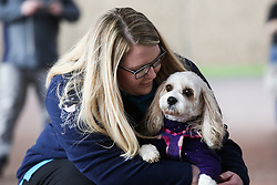 © Licensed to London News Pictures. 09/03/2017. Birmingham, UK. A woman cradles her dog at the 126th annual Crufts dog show at the NEC in Birmingham, West Midlands. The show is organised by the Kennel Club and is the biggest of it's kind in the world.  Photo credit : Ian Hinchliffe/LNP