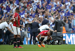 Manchester United's Anthony Martial (right) and Antonio Valencia look dejected after the game