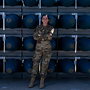 U.S. Air Force Staff Sgt. Brittney Briggs and other munitions techs in the 57th Munitions Squadron at Nellis Air Force base, Nevada, keep up a high ops tempo building missiles and inert bombs used for training on the range. The 57th MUNS is one of the busiest in the Air Force. Supporting RED Flag and the Nevada Test and Training Range. (U.S. Air Force photo by Tech. Sgt. Perry Aston)