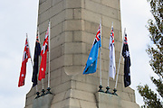 Flags flying on Cenotaph during 2007 ANZAC day parade service in Hobart Tasmania <br /> <br /> Editions:- Open Edition Print / Stock Image