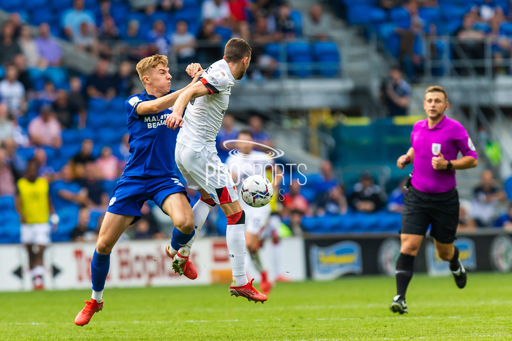 Cardiff City defender Joel Bagan  (3) battles with Bournemouth midfielder Ryan Christie (10)  during the EFL Sky Bet Championship match between Cardiff City and Bournemouth at the Cardiff City Stadium, Cardiff, Wales on 18 September 2021.