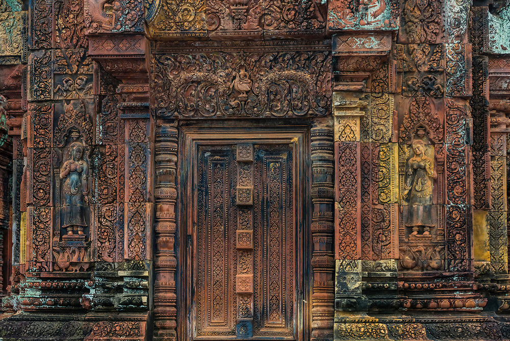 """Banteay Srei or Banteay Srey (""""Citadel of the Women"""") is a 10th-century Cambodian temple dedicated to the Hindu god Shiva. Banteay Srei is built largely of red sandstone, a medium that lends itself to the elaborate decorative wall carvings which are still observable today. The buildings themselves are miniature in scale, unusually so when measured by the standards of Angkorian construction. Angkor Wat complex, Cambodia."""