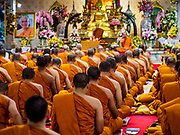 25 OCTOBER 2017 - BANGKOK, THAILAND: Buddhist monks at a temple in central Bangkok pray for the late king during the funeral for Bhumibol Adulyadej, the Late King of Thailand. He died in October 2016 and was cremated during an ornate five day funeral on 26 October 2017. He reigned for 70 years and was Thailand's longest serving monarch.         PHOTO BY JACK KURTZ