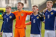 Scotland Captian Connor Smith (C)(Heart of Midlothian), Jamie Smith (Hamilton Academical), Ciaran Dickson (Rangers FC) & Liam Morrison (Celtic FC) line up for thei r national anthem ahead of the U17 European Championships match between Scotland and Russia at Simple Digital Arena, Paisley, Scotland on 23 March 2019.