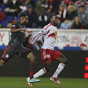 Bradley Wright-Phillips , New York Red Bulls challenged by Warren Creavalle, Toronto FC, during the New York Red Bulls Vs Toronto FC, Major League Soccer regular season match at Red Bull Arena, Harrison, New Jersey. USA. 11th October 2014. Photo Tim Clayton