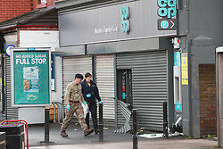 © Licensed to London News Pictures . 08/03/2020. Timperley, UK. Bomb disposal unit and police attend after explosives were used during a cashpoint robbery. Stockport Road in Timperley is closed . Photo credit: Joel Goodman/LNP