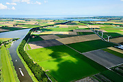 Nederland, Noord-Holland,  Gemeente Wieringermeer, 05-08-2014; overzicht noordelijk deel  Wieringermeerpolder met Waardkanaal en de Pishoek. Amstelmeer en Wieringen aan de horizon.<br /> Overview Wieringermeer polder.<br /> luchtfoto (toeslag op standard tarieven);<br /> aerial photo (additional fee required);<br /> copyright foto/photo Siebe Swart