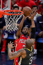 May 6, 2018 - New Orleans, LA, U.S. - NEW ORLEANS, LA - MAY 06: New Orleans Pelicans guard Ian Clark (2) shoots a jump shot against Golden State Warriors forward David West (3) during game 4 of the NBA Western Conference Semifinals at Smoothie King Center in New Orleans, LA on May 06, 2018.  (Photo by Stephen Lew/Icon Sportswire) (Credit Image: © Stephen Lew/Icon SMI via ZUMA Press)