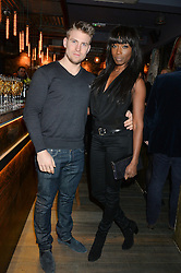 LORRAINE PASCALE and OLIVER LEE at the launch of Korean restaurant Jinjuu with chef Judy Joo at 15 Kingley Street, London on 22nd January 2015.