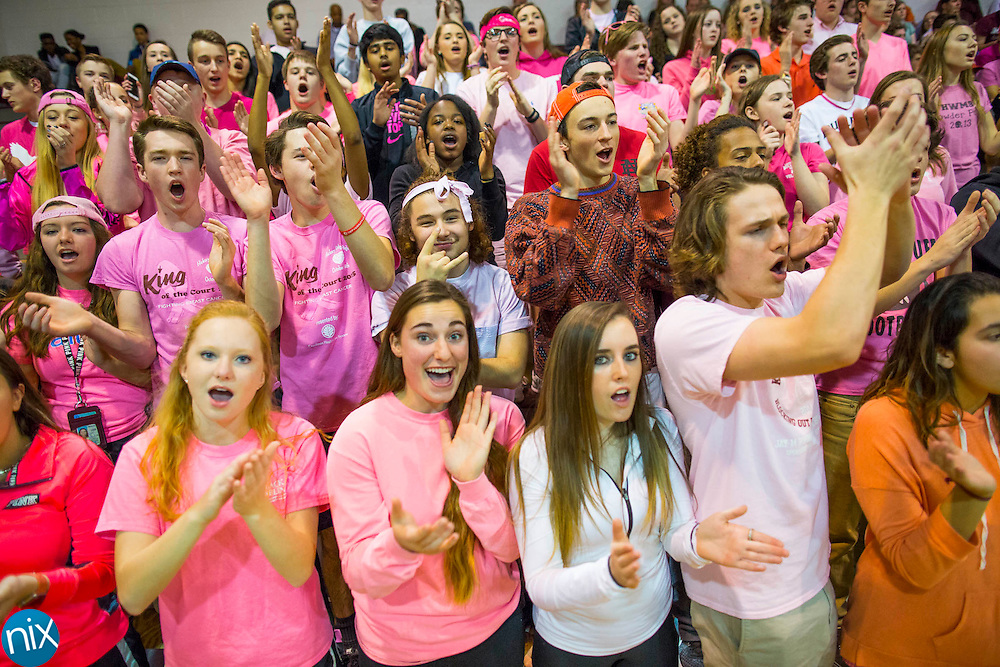 The JM Robinson student section sheers for the Bulldogs while facing Hickory Ridge during a 3A west state basketball playoff game Thursday, February 25, 2016 at Jay M Robinson High School in Concord, NC. Photo by JASON E. MICZEK - www.miczekphoto.com