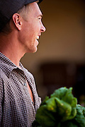 Dave Bell distributes shares of produce to customers of his Community Supported Agriculture (C.S.A.) organic farming business in Salt Lake City Utah.