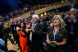 © Licensed to London News Pictures. 02/10/2018. Birmingham, UK. L to R IAIN DUNCAN SMITH MP, PRITI PATEL MP, STANLEY JOHNSON (father of Boris Johnson) and RACHEL JOHNSON (Sister of Boris Johnson) react as Boris Johnson arrives on stage to deliver a speech at day three of the 2018 Conservative Party conference at the ICC in Birmingham, where he is due to speak. This years event is focused heavily on Brexit and negotiations with the EU over the UK's exit form the European Union. Photo credit: Ben Cawthra/LNP
