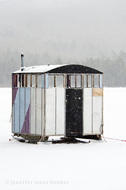 Unusual ice fishing shack in a snowstorm.