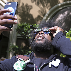 "August 21, 2017 - Hollywood, CA, USA - Ahmir Khalib Thompson known as 'Questlove' taking a break at the Four Seasons Hotel to look at the Eclipse during interviews to promote ""It Ain't Fair"" the song that he wrote for the film ""Detroitâ (Credit Image: © Armando Gallo via ZUMA Studio)"