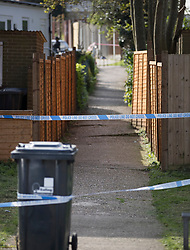 © Licensed to London News Pictures. 12/04/2017. London, UK. Police tape surrounds an alleyway off Newnham Close where a 19 year old man, named locally as Abdullahi Tarabai,  was murdered yesterday after reportedly being chased though a housing estate in Northolt. This is the second fatal stabbing in the capital in 24 hours. The location is adjacent to a gun siege from October 2016. Four men have been arrested Photo credit: Peter Macdiarmid/LNP