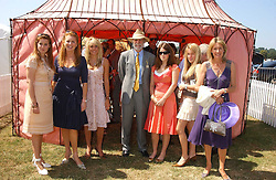 Left to right, HRH PRINCESS BEATRICE OF YORK, SARAH, DUCHESS OF YORK, the HON.ELIZA PEARSON, VISCOUNT COWDRAY, HRH PRINCESS EUGENIE OF  at the Veuve Clicquot sponsored Gold Cup Final or the British Open Polo Championship held at Cowdray Park, West Sussex on 17th July 2005.<br />