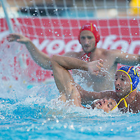 Peter Biros (front) of Hungary fights against Felipe Perrone (R) of Spain during the Vodafone Waterpolo Cup in Budapest, Hungary on July 15, 2012. ATTILA VOLGYI
