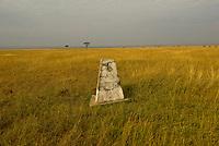 A border marker on the border of Tanzania and Kenya, Masai Mara National Reserve, Kenya