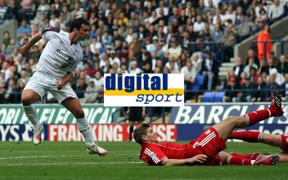 Photo: Paul Thomas.<br /> Bolton Wanderers v Liverpool. The Barclays Premiership. 30/09/2006.<br /> <br /> Gary Speed (L) of Bolton scores a goal, as it's watched by Steven Gerrard.