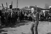 Man in a trump mask dancing in Guinness village Cheltenham races,  Ladies Day, Wednesday 15 March 2017
