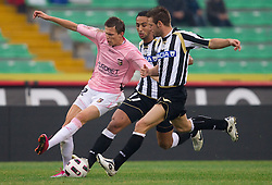 Josip Ilicic of Palermo vs Benatia and Pasquale Giovanni of Udinese during football match between Udinese Calcio and Palermo in 8th Round of Italian Seria A league, on October 24, 2010 at Stadium Friuli, Udine, Italy.  Udinese defeated Palermo 2 - 1. (Photo By Vid Ponikvar / Sportida.com)