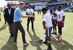 Prince Harry meets boxers as he attends a youth sports festival at the Sir Vivian Richards Stadium in North Sound, Antigua, on the second day of his tour of the Caribbean.