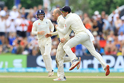 November 9, 2018 - Galle, Sri Lanka - England cricketer Jack Leach celebrates with Jos Butler celebrate after taking a wicket during the 4th day's play of the first test cricket match between Sri Lanka and England at Galle International cricket stadium, Galle, Sri Lanka. 11-09-2018  (Credit Image: © Tharaka Basnayaka/NurPhoto via ZUMA Press)